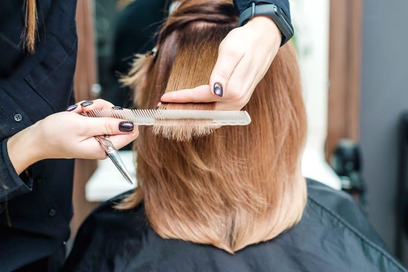 Hairstylist cutting hair