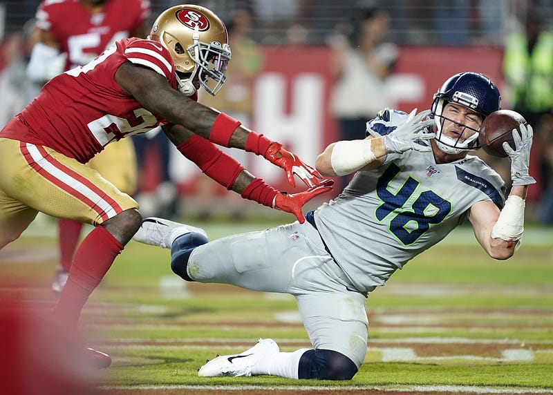 Seahawks tight end Jacob Hollister beats a defender for the catch