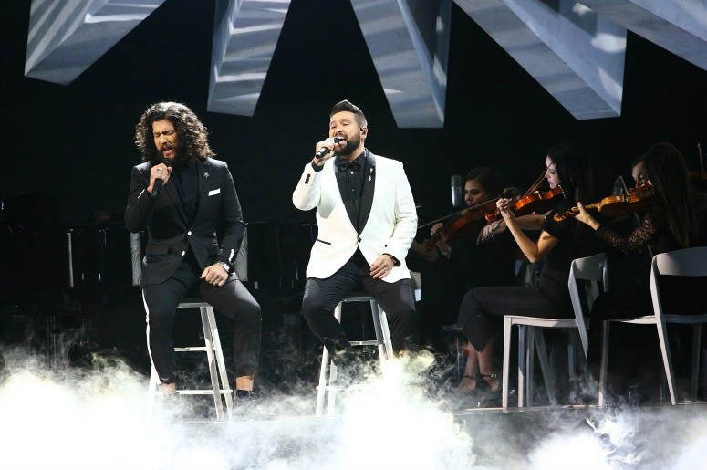 Dan Smyers and Shay Mooney of Dan + Shay performs onstage during the 53rd annual CMA Awards