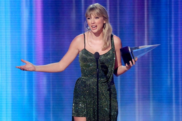 Taylor Swift accepts the Favorite Album - Pop/Rock award for 'Lover' performs onstage during the 2019 American Music Awards
