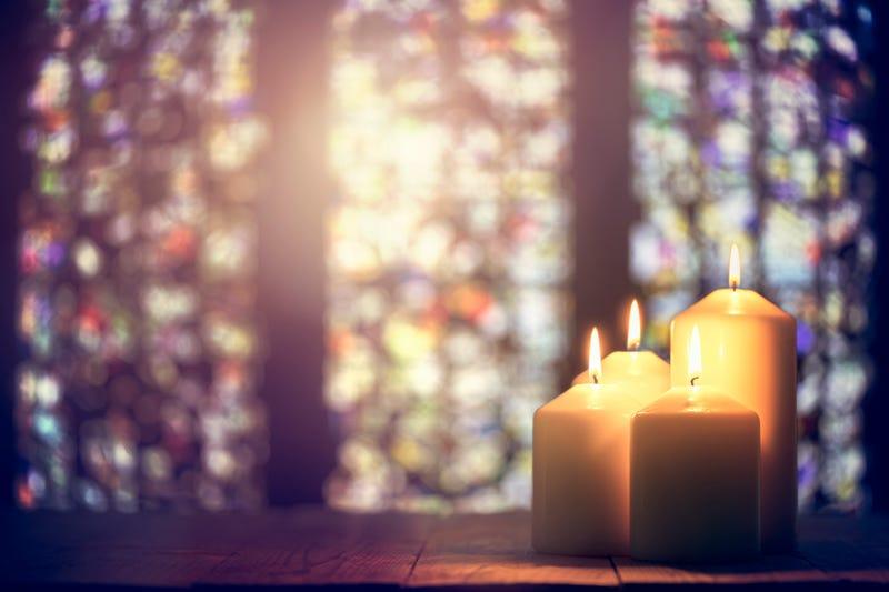 Prayer candles burning in a church