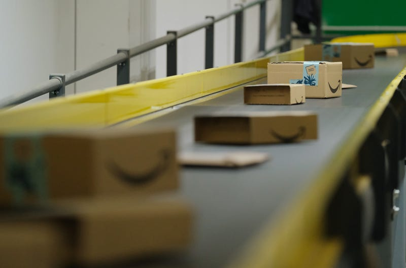 BRIESELANG, GERMANY - NOVEMBER 28: Packages flow along a conveyor belt at an Amazon packaging center on November 28, 2019 in Brieselang, Germany. Amazon is anticipating a strong holiday season and has hired extra workers at its packaging center across Germany. Meanwhile workers at some of the centers, though not at Brieselang, have announced strikes to further their demands for better pay.
