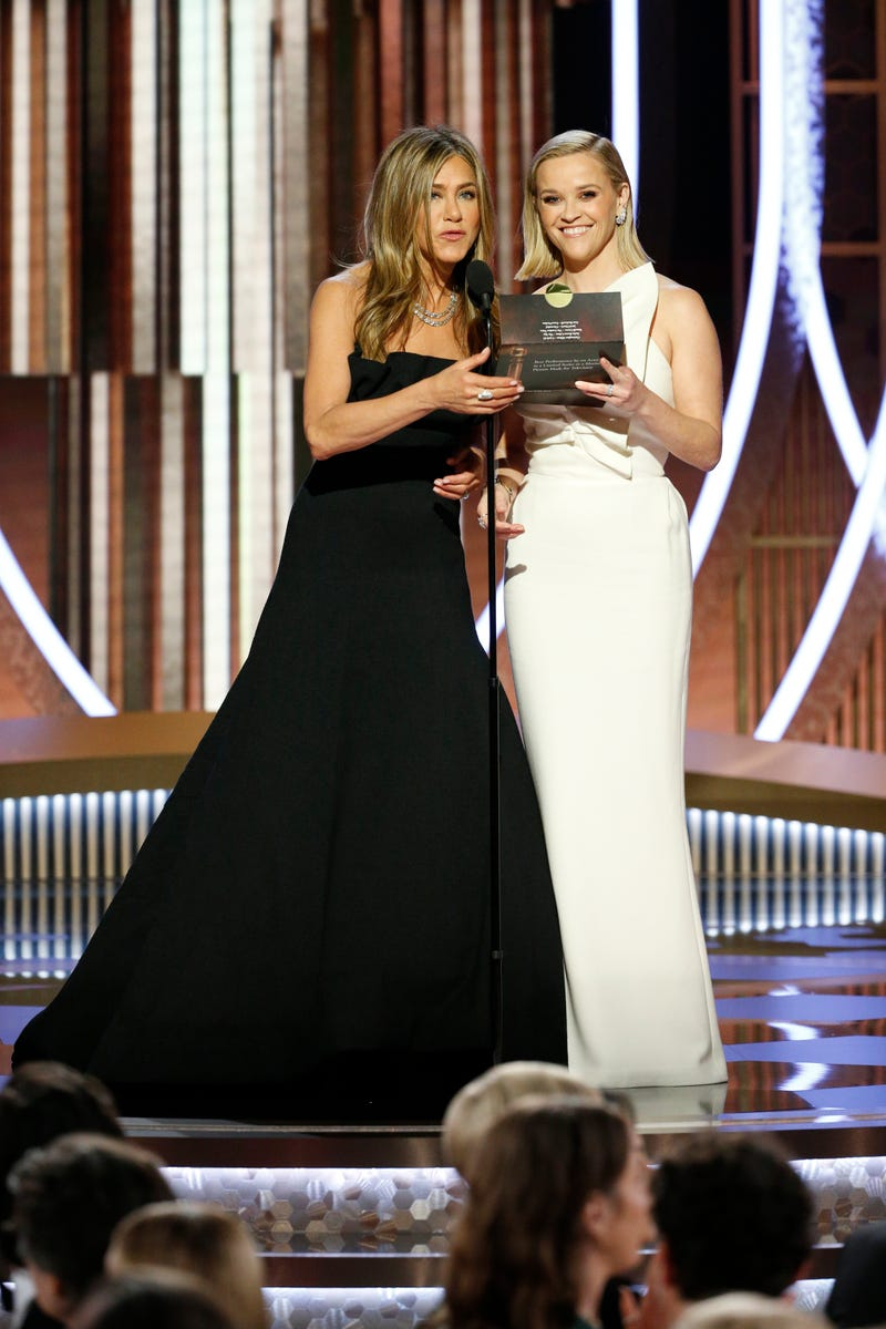 presenters Jennifer Aniston and Reese Witherspoon accept award on behalf of russell crowe