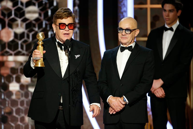 "Elton John and Bernie Taupin accept the award for their song ""(I'm Gonna) Love Me Again"""