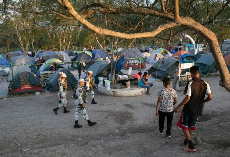 Mexican National Guard troops patrol through a camp for asylum seekers on December 08, 2019 in the border town of Matamoros, Mexico.