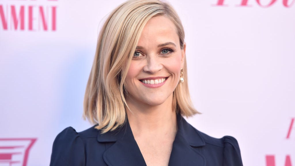 Reese Witherspoon, 45, drifts on pool float in iconic pink bikini for 'Legally Blonde' 20th anniversary
