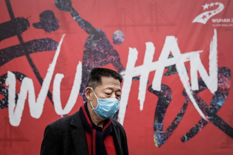 "A man wears a mask while walking in the street on January 22, 2020 in Wuhan, Hubei province, China. A new infectious coronavirus known as ""2019-nCoV"" was discovered in Wuhan as the number of cases rose to over 400 in mainland China."