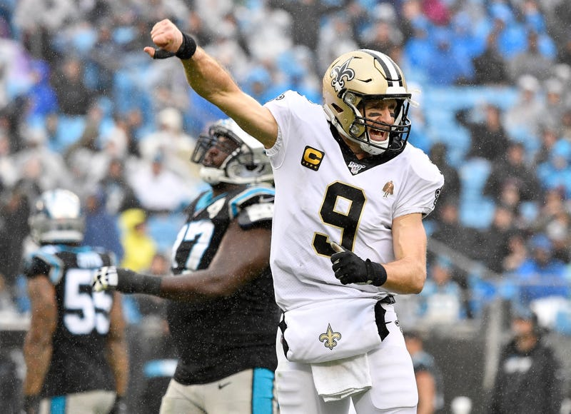 Drew Brees reacts to throwing a touchdown against Carolina