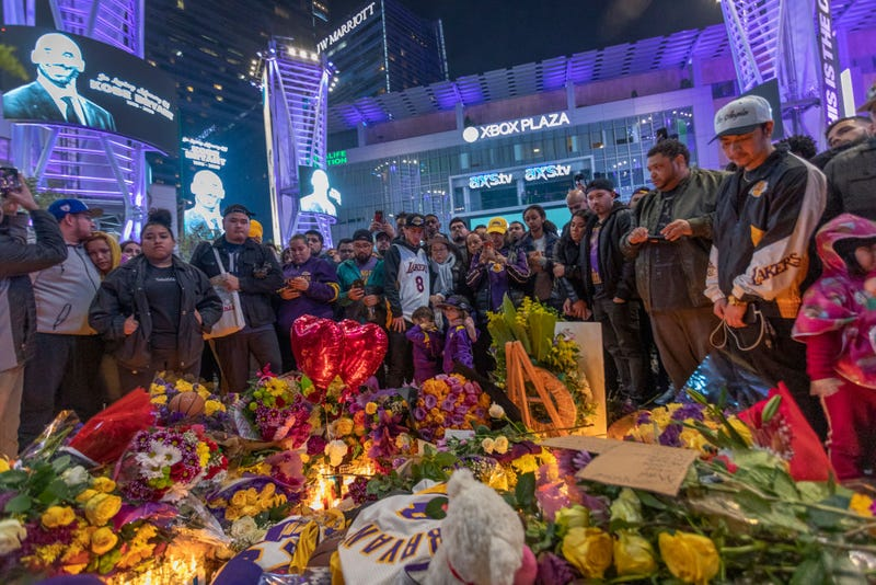 People mourn for former NBA star Kobe Bryant, who was killed in a helicopter crash in Calabasas, California, near Staples Center on January 26, 2020 in Los Angeles, California. Nine people have been confirmed dead in the crash, among them Bryant and his 13-year-old daughter Gianna.