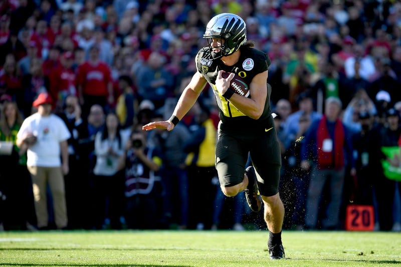 Oregon quarterback Justin Herbert keeps it himself