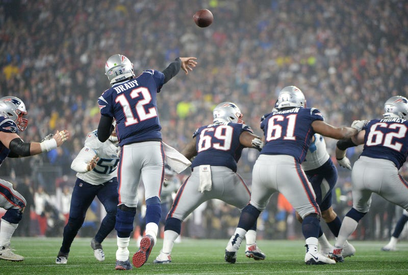 Tom Brady getting off a pass against the Tennessee Titans