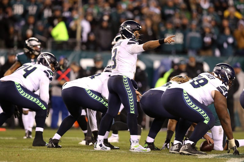 Russell Wilson commands the huddle