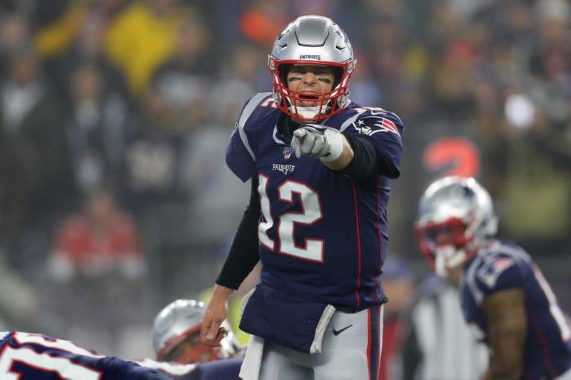 Patriots QB Tom Brady commands the huddle
