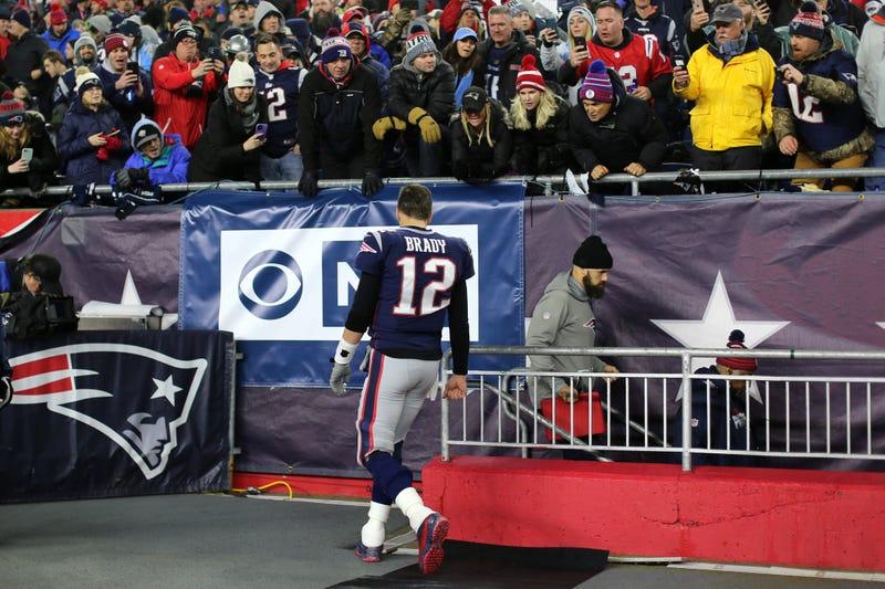 Tom Brady retreats to the Patriots' locker room at Gillette Stadium