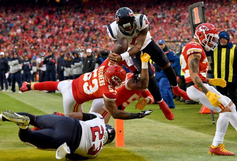Deshaun Watson goes airborne for a touchdown against Kansas City