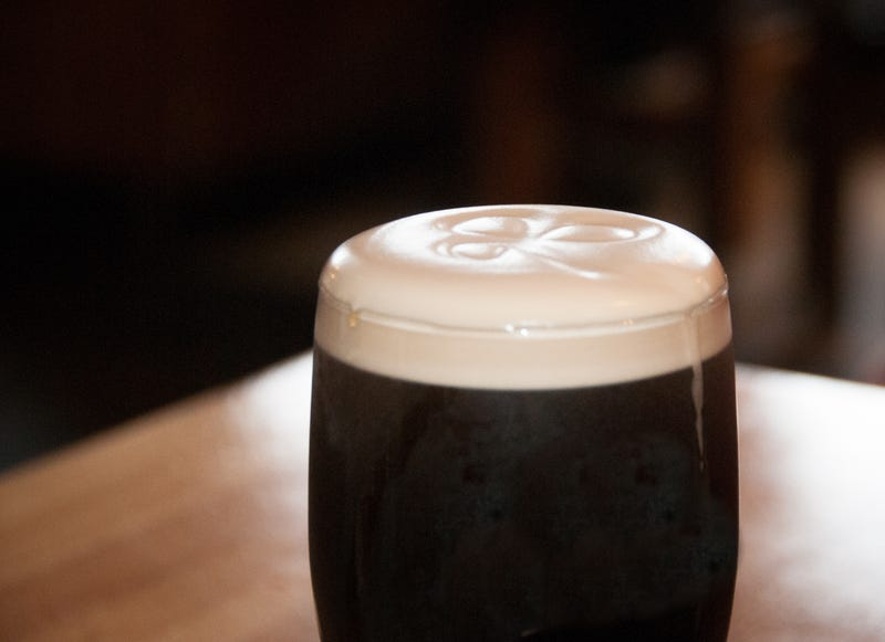dark beer with shamrock in foam