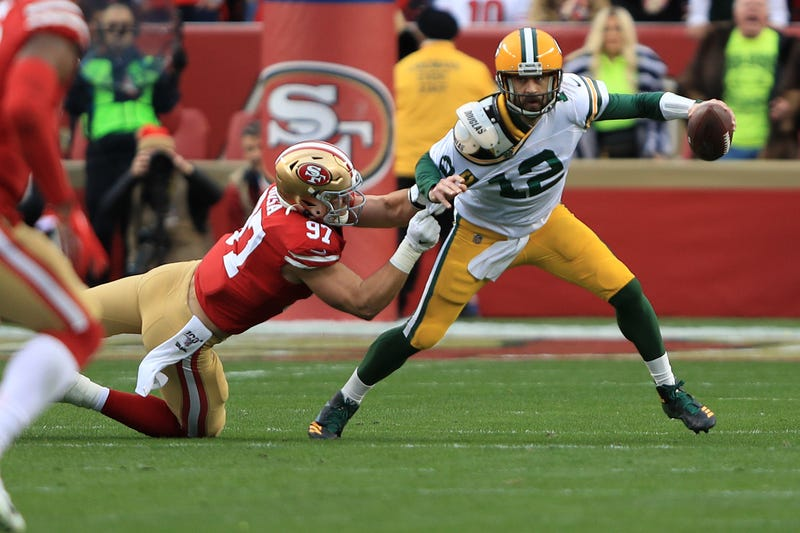 Aaron Rodgers tries to escape 49ers defender Nick Bosa