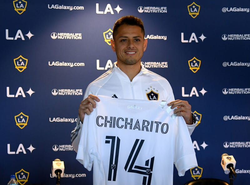 """Javier """"Chicharito"""" Hernandez poses with his jersey during a press conference at Dignity Health Sports Park on January 23, 2020 in Carson, California."""