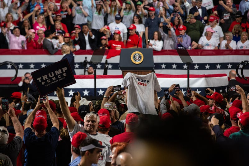 Supporters of President Donald Trump hold a shirt that says Trump 2024 at a rally in Arizona in February 2020.