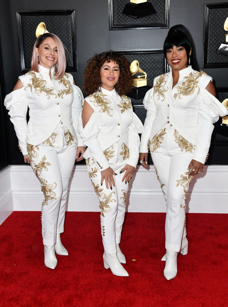 Shae Fiol, Julie Acosta and Mireya Ramos of the band Flor de Toloache attend the 62nd Annual GRAMMY Awards at STAPLES Center on January 26, 2020 in Los Angeles, California.