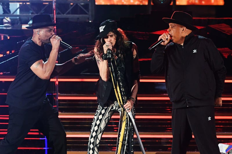 oseph Simmons of music group Run–D.M.C., Steven Tyler of music group Aerosmith, and Darryl McDaniels of music group Run–D.M.C. perform onstage during the 62nd Annual GRAMMY Awards