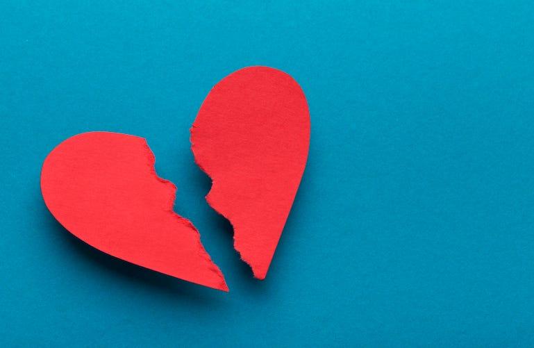 Broken heart on blue background