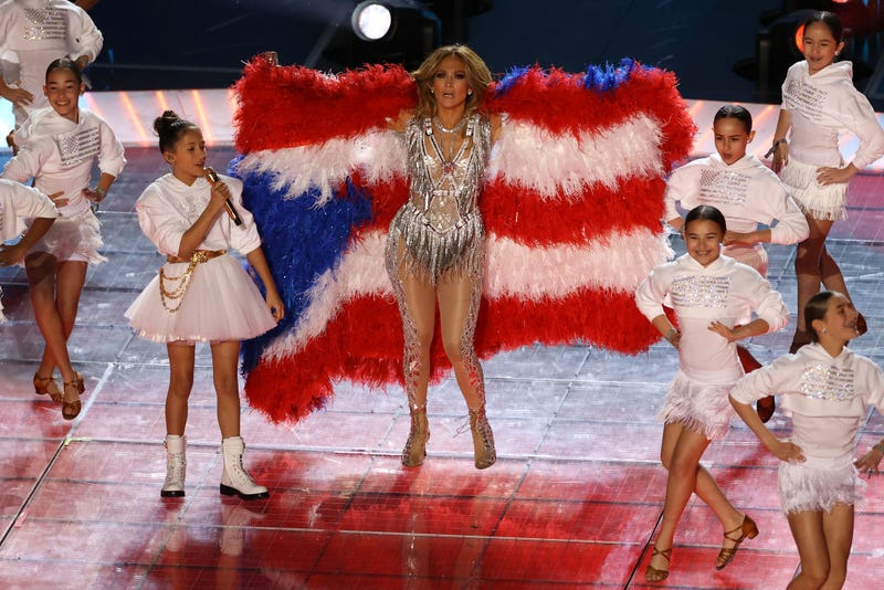 Singer Jennifer Lopez and her daughter Emme Maribel Muñiz perform while a Puerto Rican flag is displayed on stage during the Pepsi Super Bowl LIV Halftime Show at Hard Rock Stadium on February 02, 2020 in Miami, Florida.