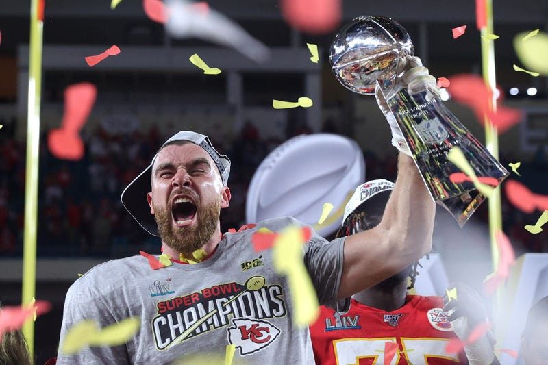 Travis Kelce hoists the Lombardi Trophy following the Chiefs' Super Bowl win over San Francisco