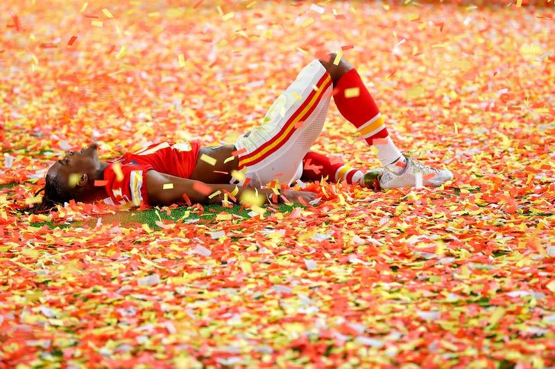 Confetti falls as Demarcus Robinson celebrates the Chiefs' Super Bowl victory