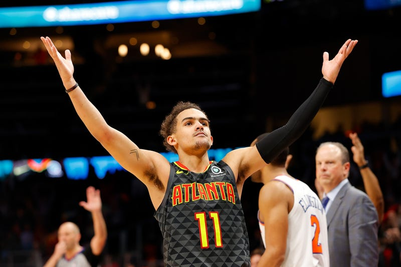 Hawks guard Trae Young celebrates after knocking down a big shot