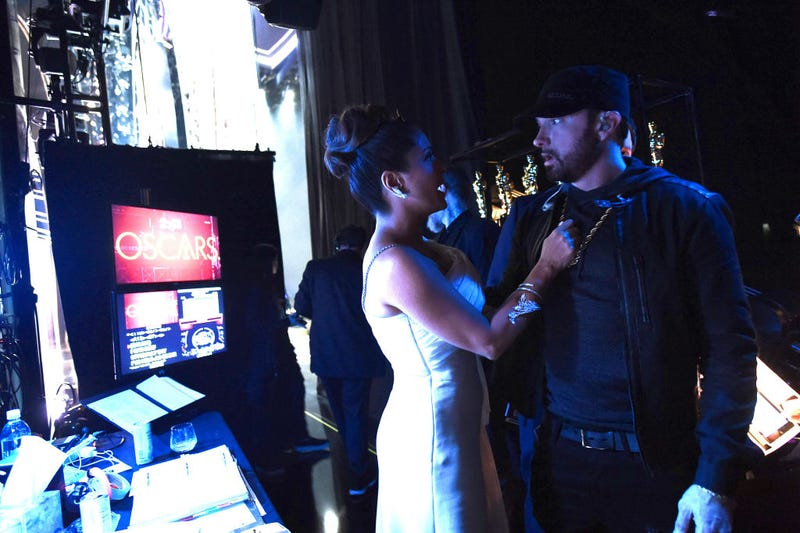 In this handout photo provided by A.M.P.A.S. Salma Hayek Pinault and Eminem pose backstage during the 92nd Annual Academy Awards at the Dolby Theatre on February 09, 2020 in Hollywood, California.