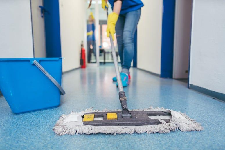 Custodian wiping floor