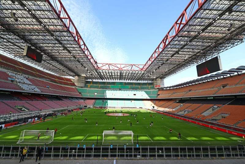 AC Milan and Genoa CFC players warm up in the empty stadium after rules to limit the spread of Covid-19 have been put in place before the Serie A match between AC Milan and Genoa CFC at Stadio Giuseppe Meazza (also known as the San Siro stadium) on March 8, 2020 in Milan, Italy.