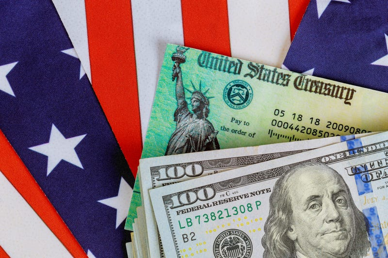 Money, American flag and check.