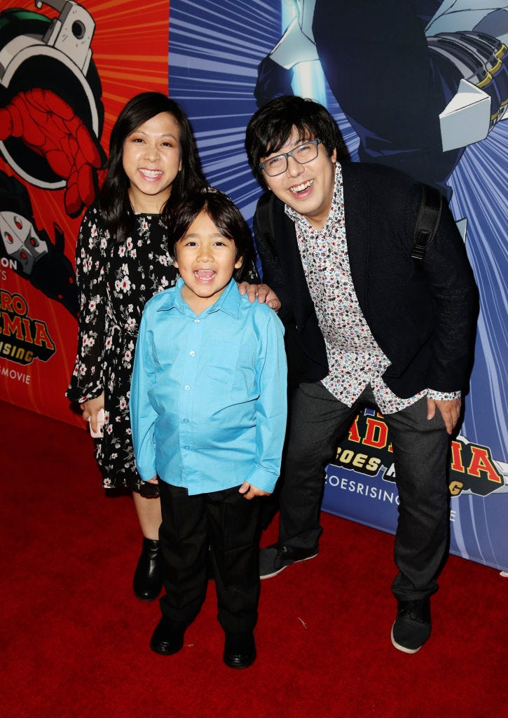 Ryan Kaji (center) with mother Loann Kaji (left) and Shion Kaji (right)