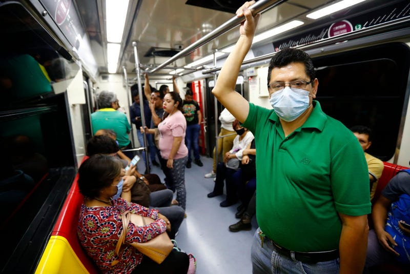 Commuters using the light rail transit train, wear face mask as a preventive measure to avoid the infection of COVID-19, on March 27, 2020 in Guadalajara, Mexico. While most countries and major cities have ordered a lockdown to halt COVID-19 spread, Mexican president Lopez Obrador has not called for national quarantine yet. His critics argue he downplays on coronavirus threat as he seek to protect the economy. In Guadalajara, measures to avoid the spread of the COVID-19 have been taken, schools of all levels are closed since March 16, business around the city must shut down and many tests will be taken in people suspected to be infected. 64 cases have been confirmed in Mexican State of Jalisco.