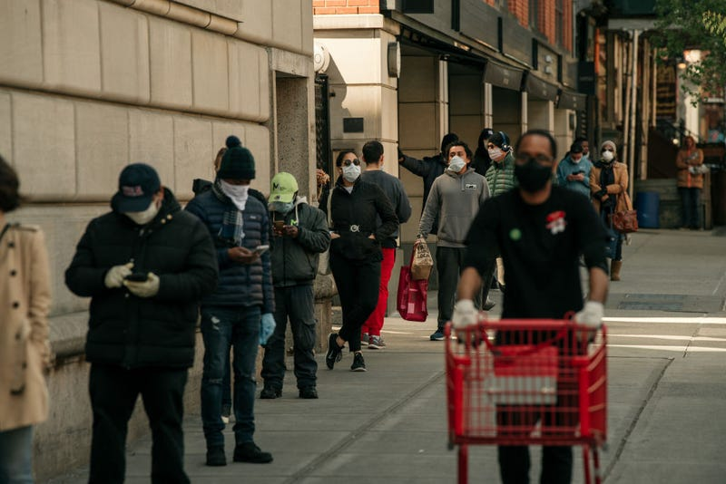 Shoppers stand in line apart from each other at a supermarket amidst calls for social distancing and a high demand for groceries on April 15, 2020 in the Cobble Hill neighborhood of the Brooklyn borough in New York City.