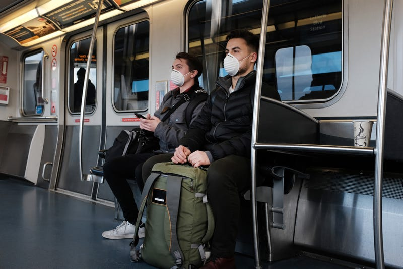 People wear medical masks on the AirTrain as concern over the coronavirus grows en route to John F. Kennedy Airport (JFK) on March 7, 2020 in New York City.