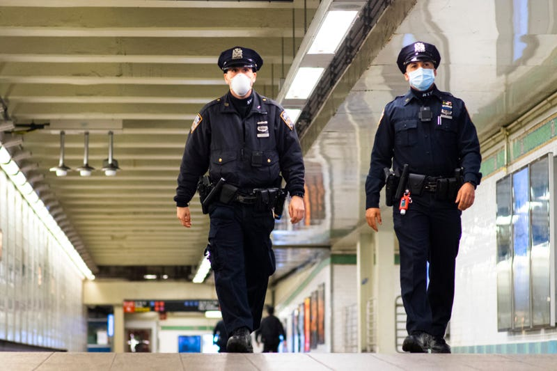 File photo: NYPD officers patrol inside Times Square station last May