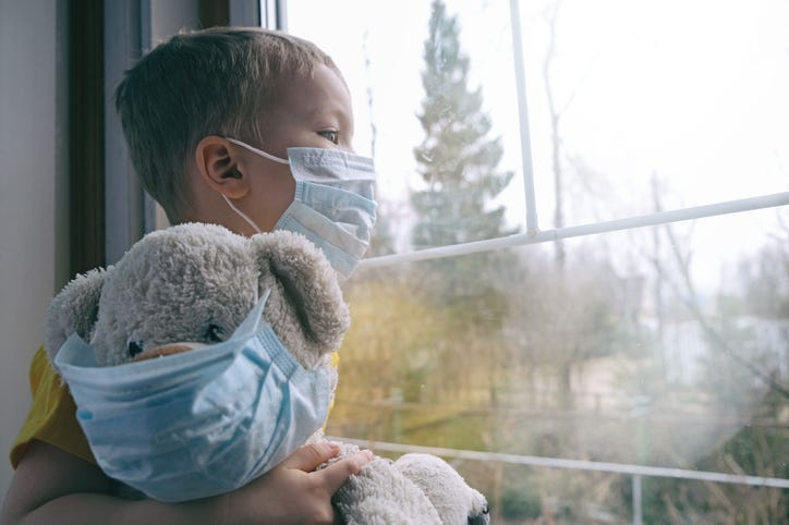 child wearing face mask with teddy bear