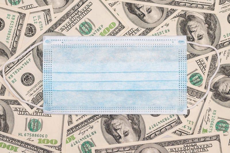 medical mask on bank notes