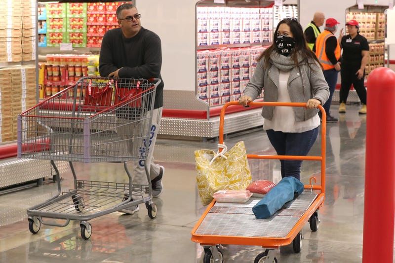 Shoppers walk down the aisles at Costco