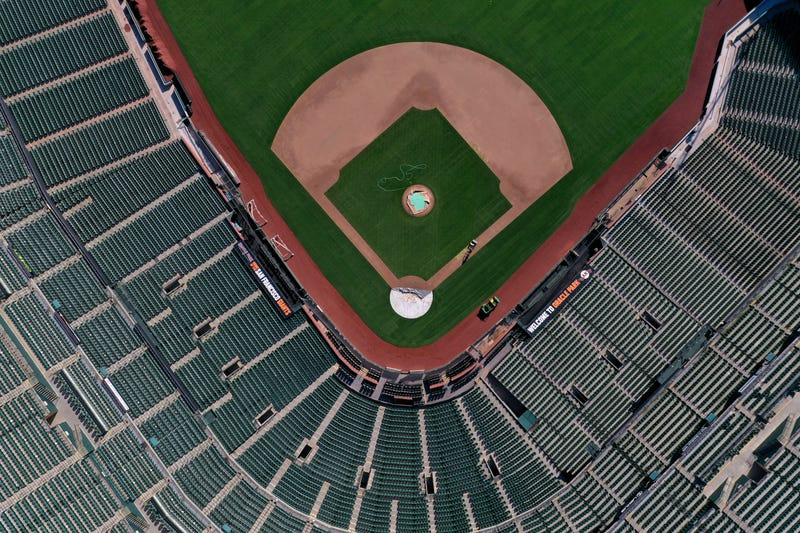 An aerial view from a drone shows Oracle Park, home of the San Francisco Giants, empty on Opening Day March 26, 2020 in San Francisco, California.