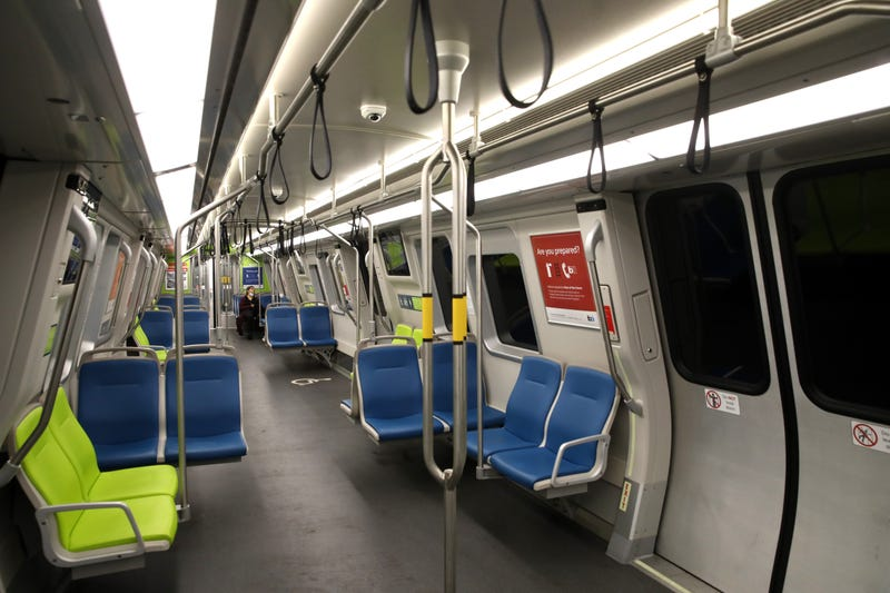 A Bay Area Rapid Transit (BART) passenger rides in an empty train car on April 08, 2020 in San Francisco, California.