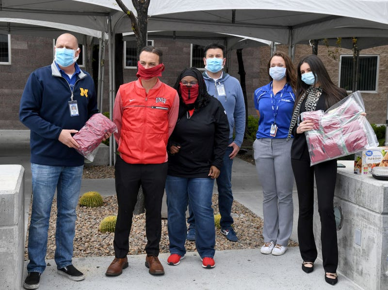 Ronald Roemer from University Medical Center of Southern Nevada, UNLV Senior Associate Athletics Director for External Affairs John Gladchuk, UNLV Assistant Athletic Director, Equipment and Purchasing, Tausha Smith and Robert Bimbi, Kelly Cullerton and Marsha Al-Sayegh from UMC pose for photos after Gladchuk and Smith donated 1,500 cloth masks from UNLV Athletics to the hospital as the medical community continues to battle the coronavirus on April 10, 2020 in Las Vegas, Nevada. UNLV Athletics student-athletes, coaches, staff and their families are making a total of 3,000 masks made out of T-shirts supplied by Nike and the Andre Agassi Foundation for Education for the hospital. The World Health Organization declared the coronavirus (COVID-19) a global pandemic on March 11th.