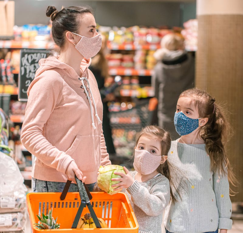 Mother shopping with her children.