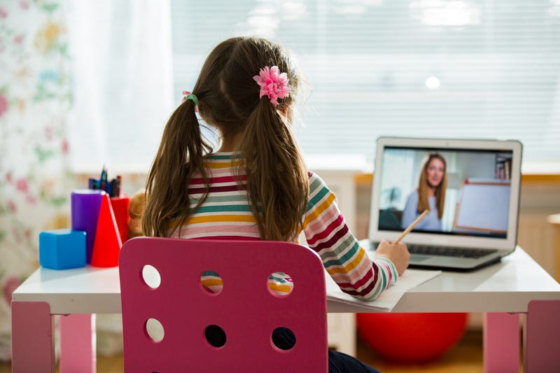 child using laptop for virtual class
