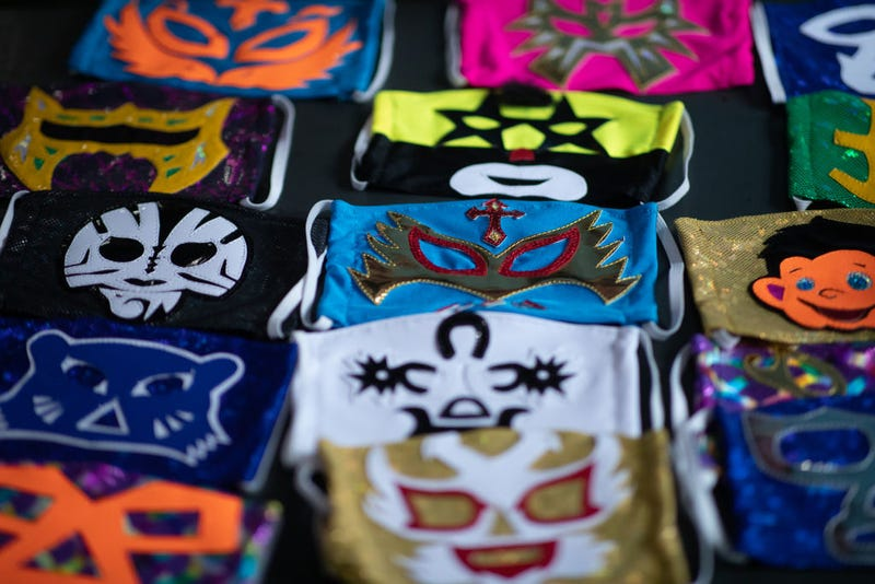 View of face masks from different Mexican Lucha Libre fighters on April 20, 2020 in Puebla, Mexico. Due to the COVID-19 pandemic, Huerta turned to produce themed protective masks in his own Lucha Libre masks studio, using the same materials.