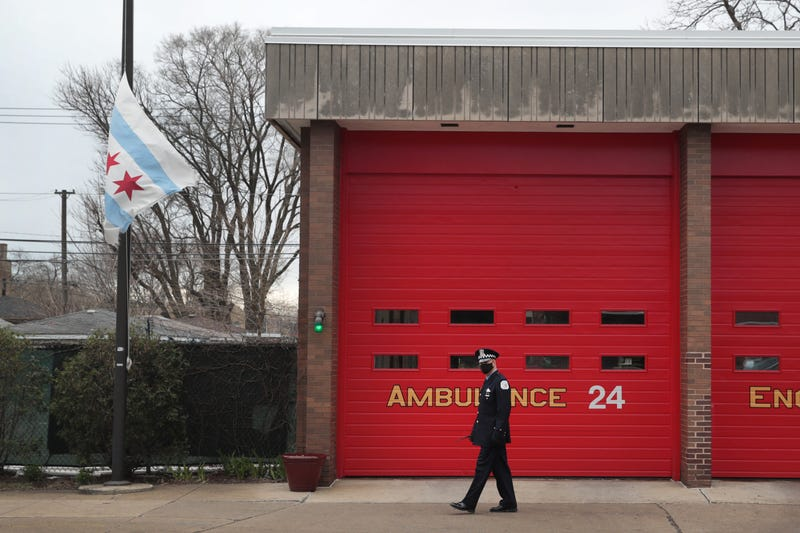 A city of Chicago flag flies at half mast outside of a firehouse near the Taylor Funeral Home where a service was being held for Firefighter Edward Singleton, a 33 year veteran of the Chicago Fire Department, on April 22, 2020 in Chicago, Illinois.
