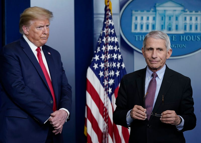 Dr. Anthony Fauci (R), director of the National Institute of Allergy and Infectious Diseases, and U.S. President Donald Trump participate in the daily coronavirus task force briefing at the White House on April 22, 2020 in Washington, DC.
